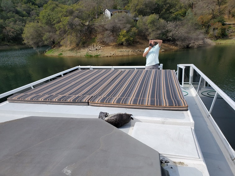 Custom padded sundeck designed and constructed by James Boat and Fiberglass Repair, Dixon, CA for this large houseboat