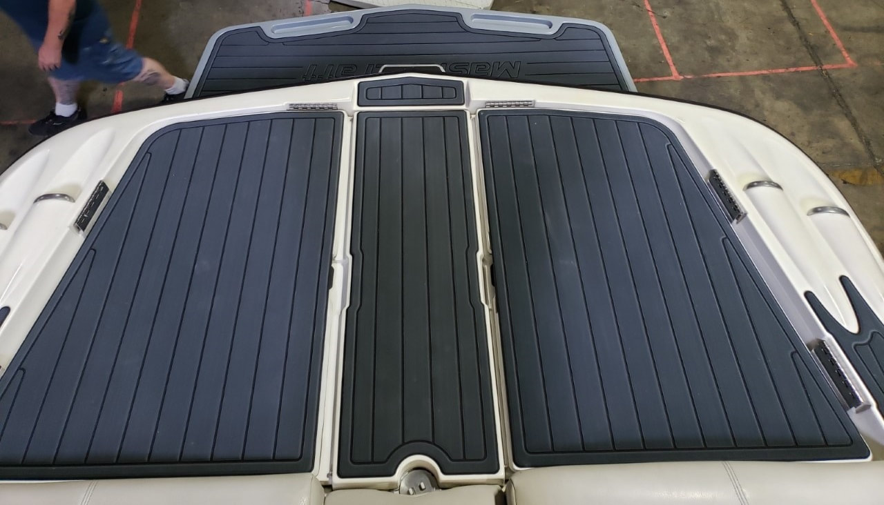 Added sea deck to back of MasterCraft x45 on deck, storage doors